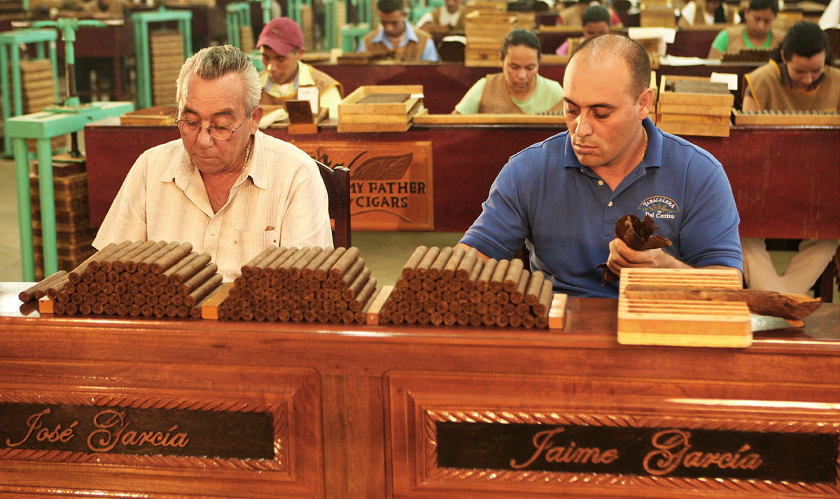 Don Pepin and Jaime Garcia of My Father Cigars are rolling cigars